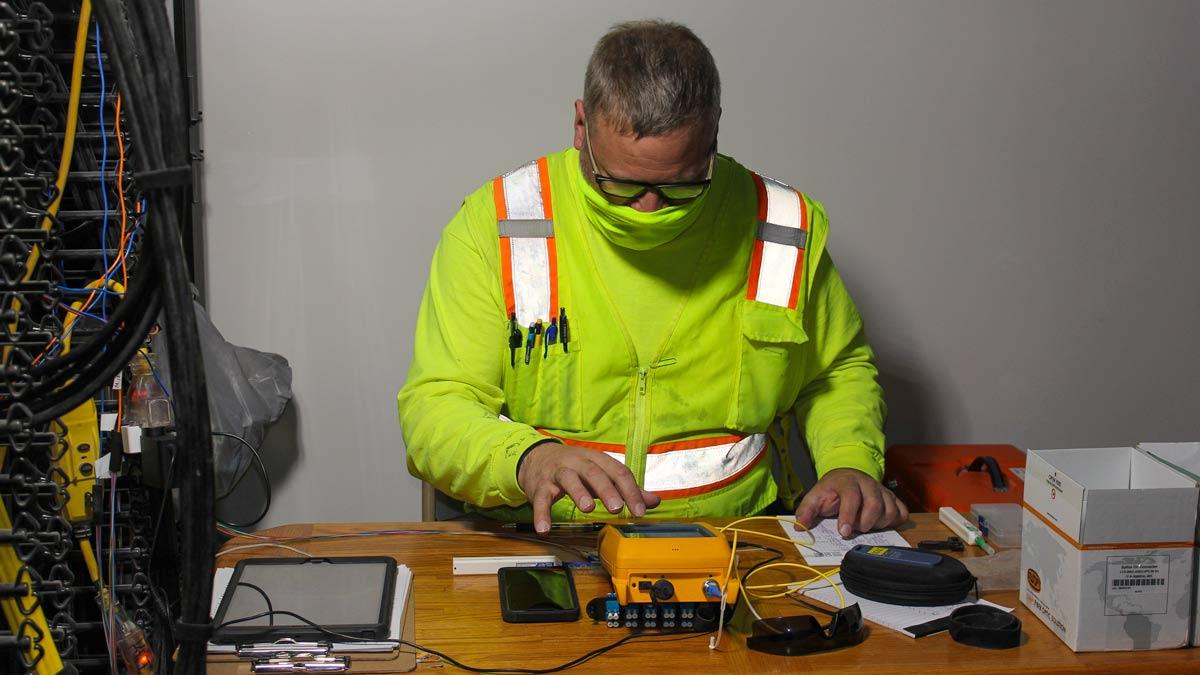 Technician splicing fiber optic cable